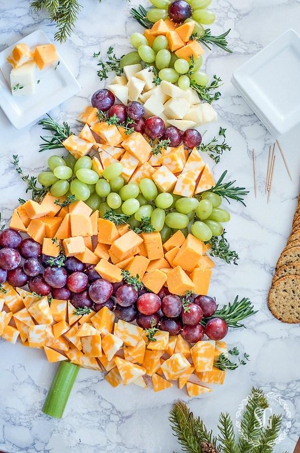 CHRISTMAS-TREE-CHEESE-BOARD-cheese-grapes-herbs.jpg