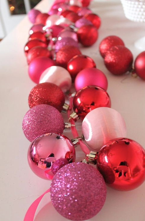 The easiest way to coordinate a color themed party is with the decor. Keep DIYs monochromatic for a chic look that's sure to stun. This ornament garland is super easy and beautiful across the table. Plus, it makes a big impact for not a lot of money.