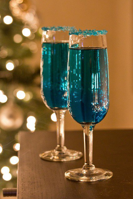 You've got to serve a festive drink! Bonus points if that drink fits your color theme! Wouldn't these bright beauties be a fun addition to your holiday soiree? We love special details like the sugar rimmed glass. Find a few areas to really go over the top to wow your guests!