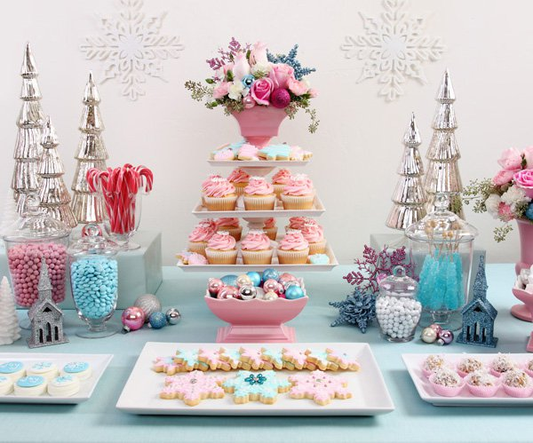 Add levels to the food display for visual interest. We especially love wrapped boxes to add height. When planning the menu consider the visual appearance of your food and how it will add to the party. Add decor and color coordinating details to make the food table match the theme of the party. You can't got wrong with a dessert table! Add color coordinated candy to tie everything together.
