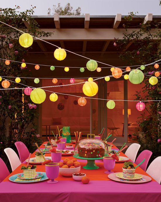 SO MUCH GOODNESS! We love the lights, (a nod to the invite) and the bright dishes and decor. Show your guests you care by putting a little extra effort into the details of your party!