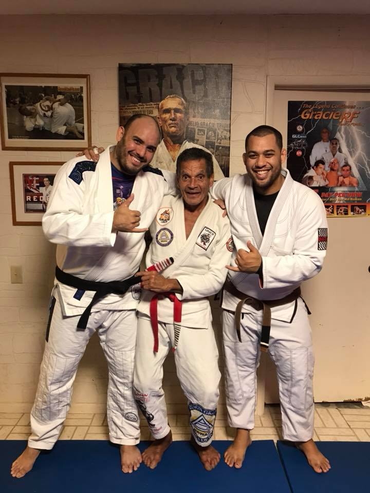 Kimo Kreis receiving his 5th degree Black Belt from Master Relson Gracie 9th Degree and Vinney Miller