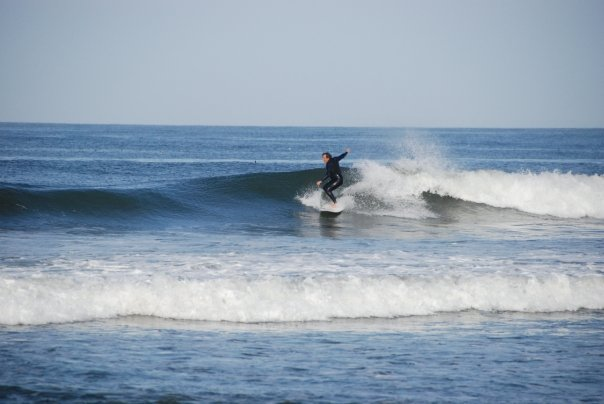 Larry catching a few waves