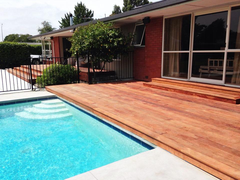 landscapes-unlimited-hardwood-deck-pool-paving-back.jpg