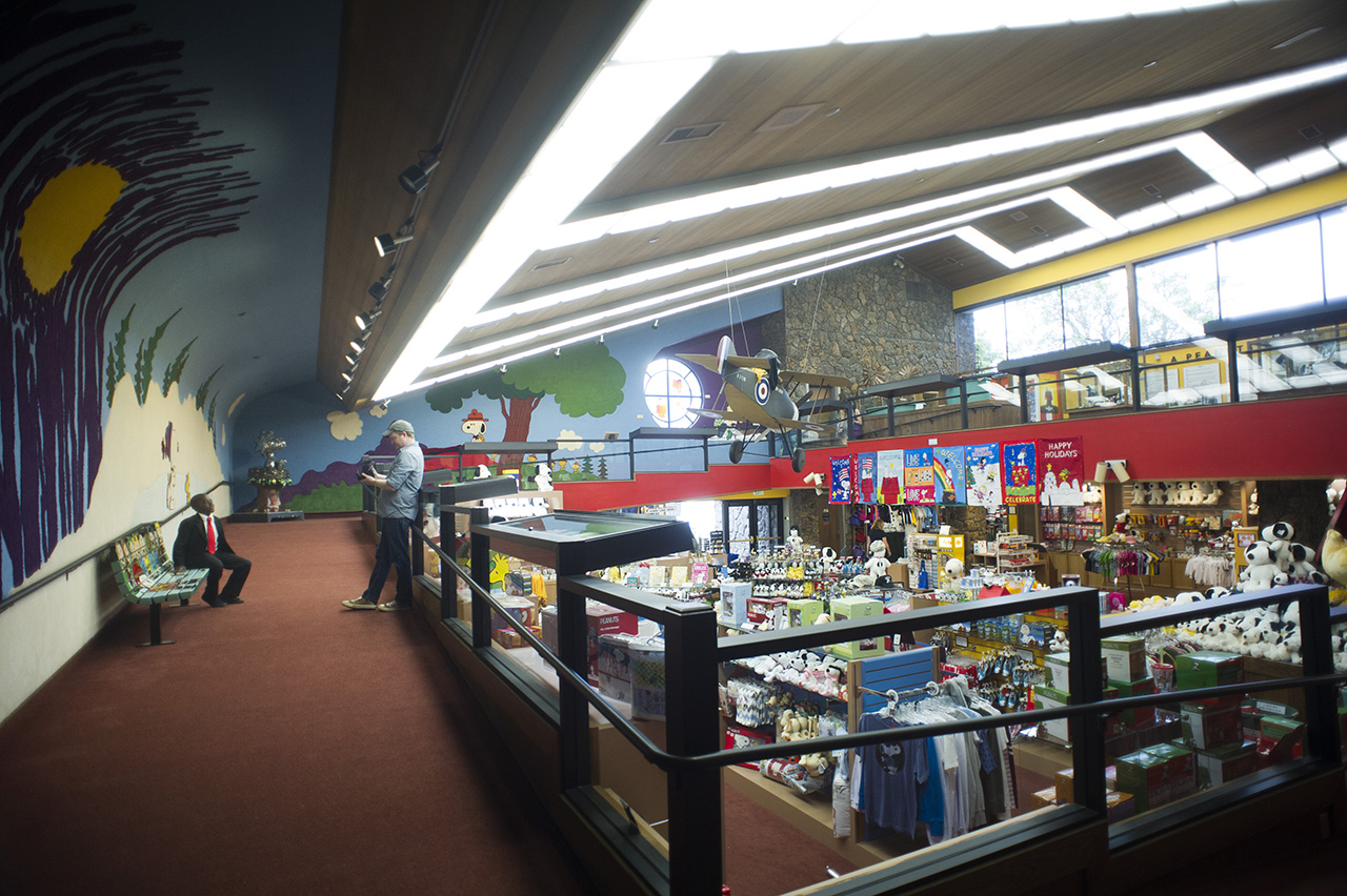 Brad and Robby shooting in the gift shop. All of the architecture is so wonderfully late 60's and early 70's, and those colorful murals are made out of carpet!
