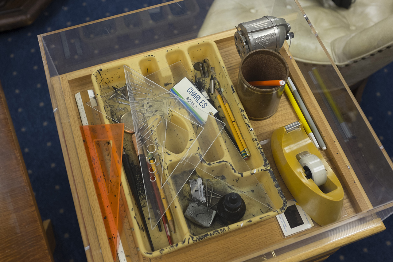 They put a plexiglass case over his tools--they're left exactly how they were when he passed away.