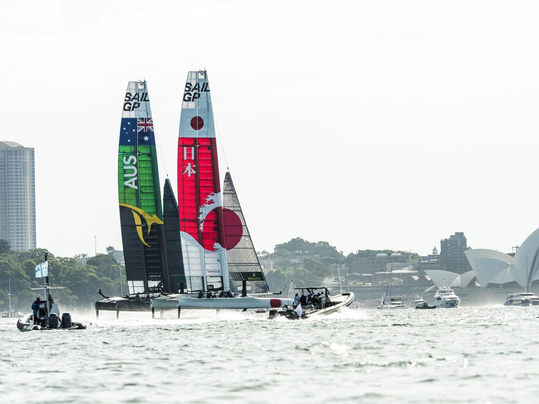 The International Media contingent follow the final match race between Australia & Japan