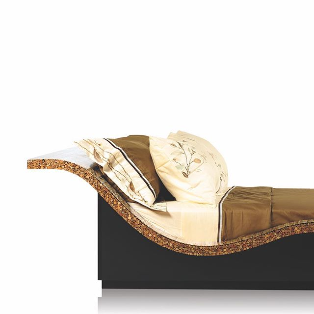 A gliding silhouette on our WAVESCAPE bed that is laminated in Natural Rattan.