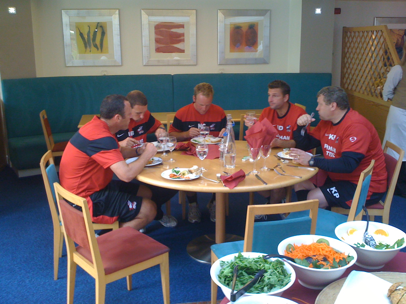 Collaboration - Assistant Manager Andy Crosby, Coach Ian Baraclough, Kitman Nick Crawford, Physiotherapsit Alex Dalton and Goalkeeping Coach Kevin Pressman. Fantastic togetherness and spirit. Eating together during Scunthorpe United pre-season training camp for the Championship Season, July 2010, Champney Springs, Leicestershire.