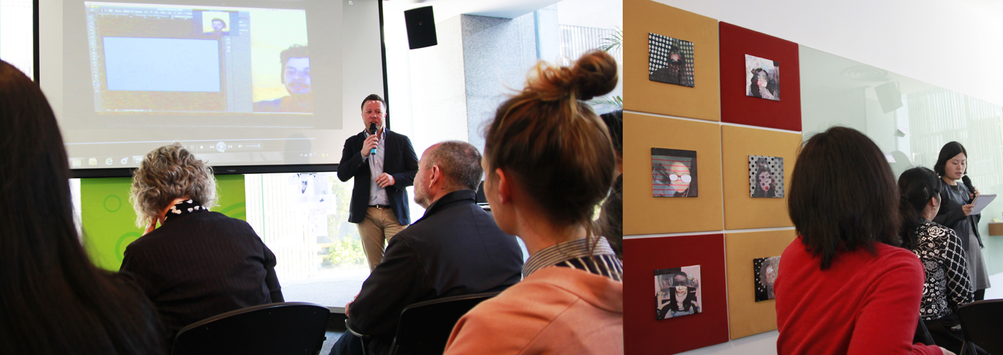 Dr. Claus Heimes presenting at German Consulate General, video on screen by Thi To Uyen Ly, artworks on the right by Annie Kurz