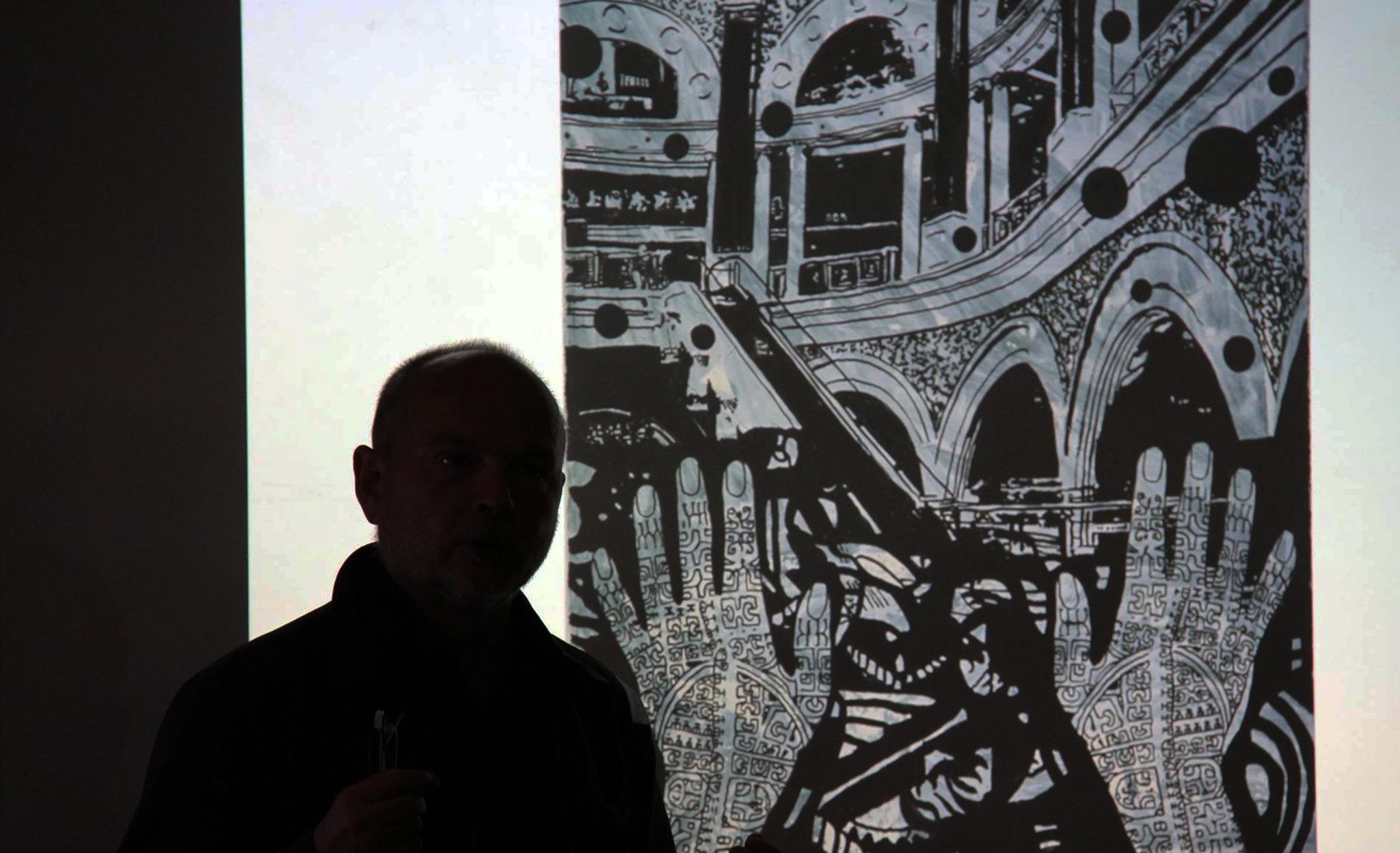 Henning Eichinger and his painting. Photo: Ceri Hann