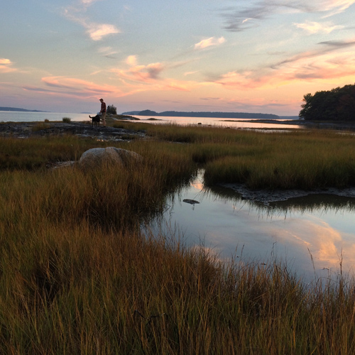Lee and his dog Marley enjoying the sunset at Flying point, brunswick, Maine.