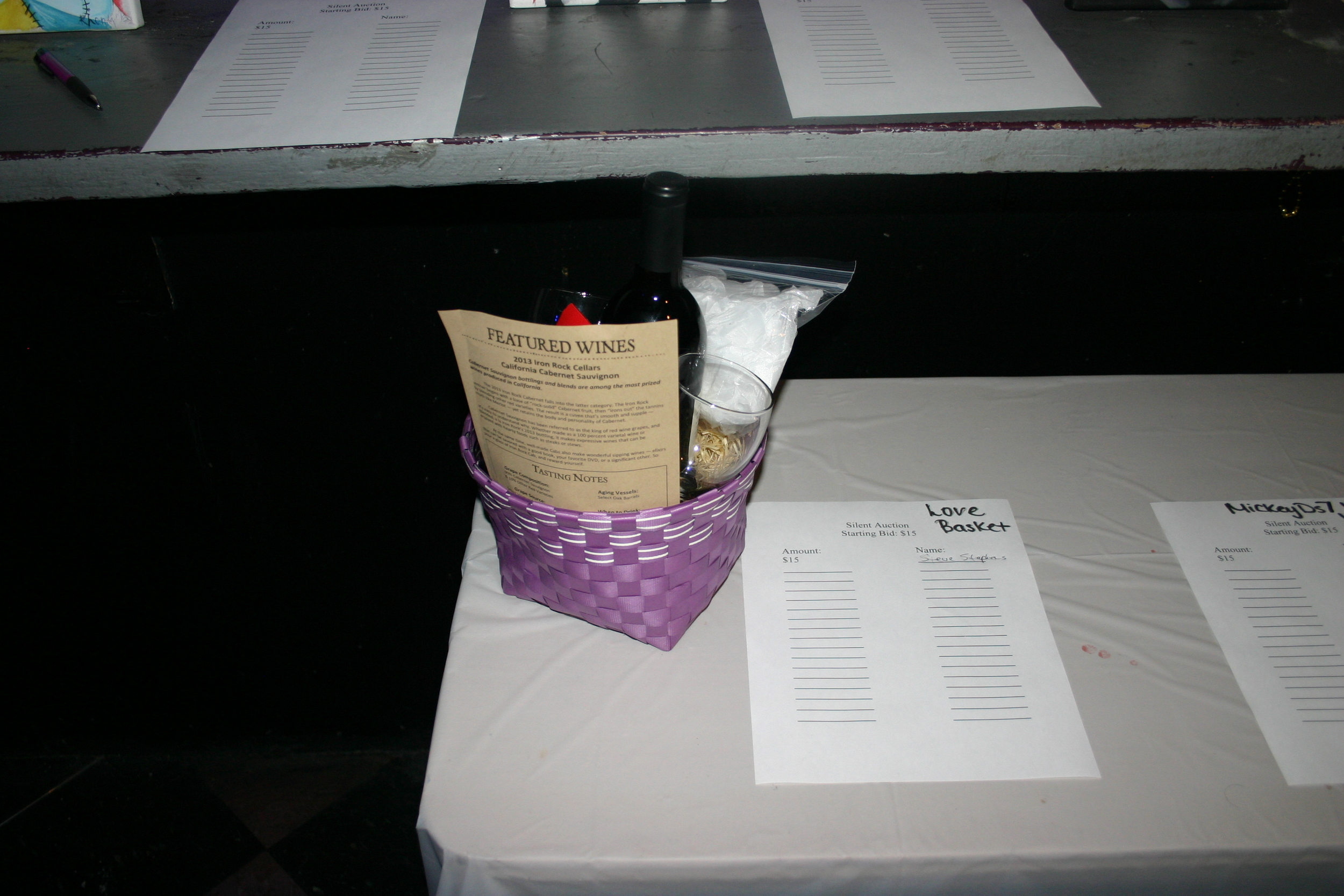 Silent Auction Items included wine and art work at the Third Annual Love Doesn't Hurt Fundraiser at Spectrum Nightclub March 27, 2015