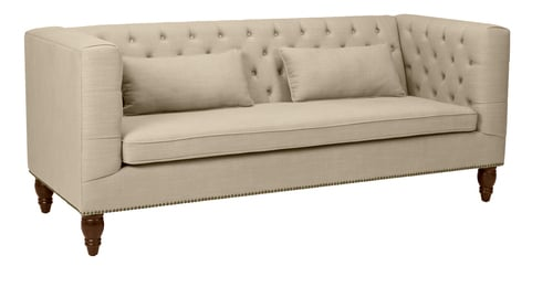 beige button back three seater sofa