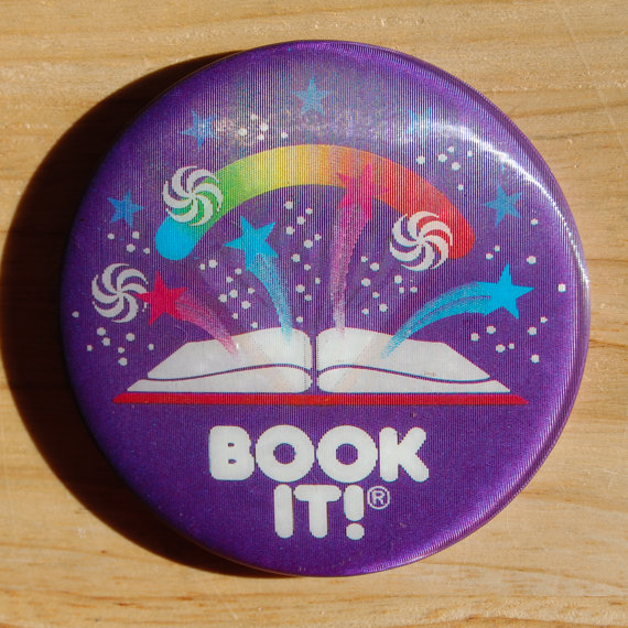 I proudly wore my Book It! pin. You earned a gold star for each book you read. When you filled up your pin, you got a free personal pan pizza.