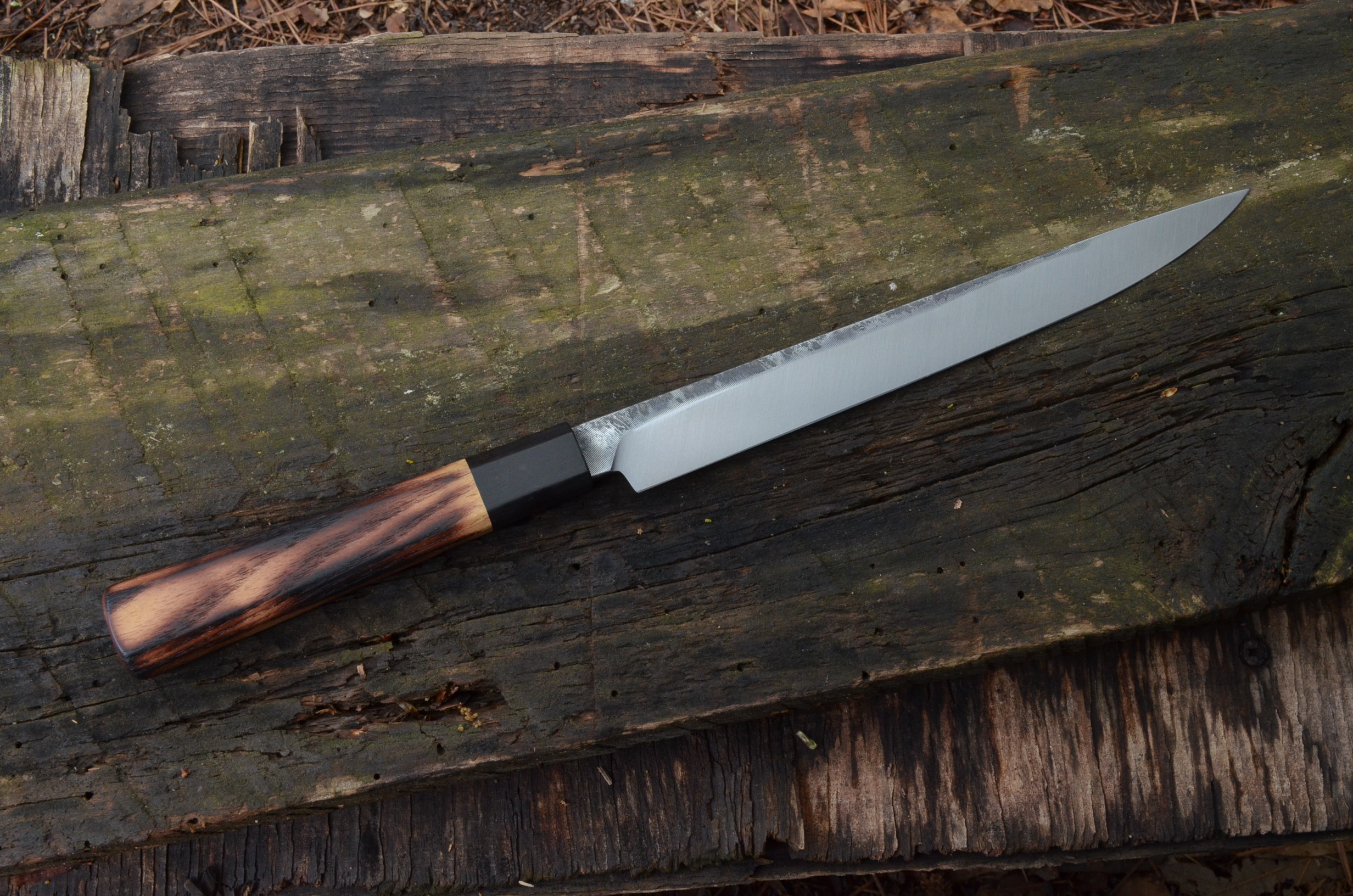 225mm Hybrid with Flame-grained black locust and blackwood octagonal handle. Retained filemarks.