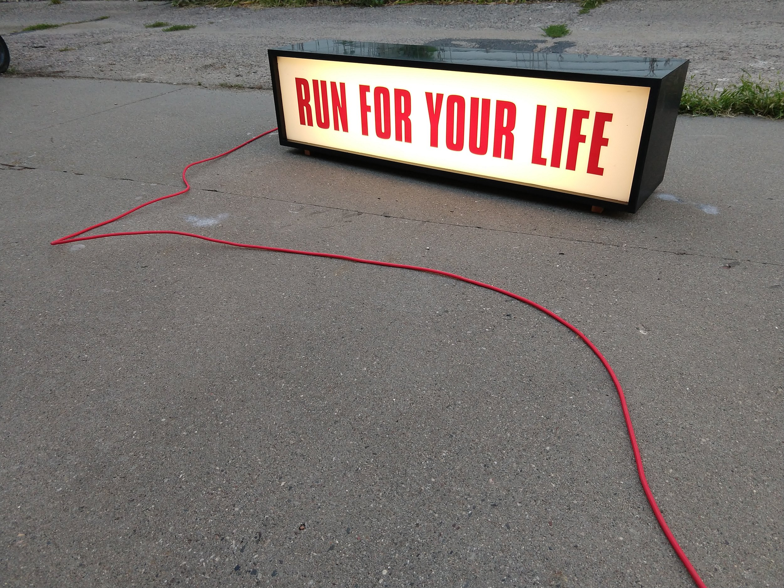 """RUN FOR YOUR LIFE"" 2018 Jacob Swogger, 41""x8""x10"" MDF / Acrylic / Vinyl / LEDs"