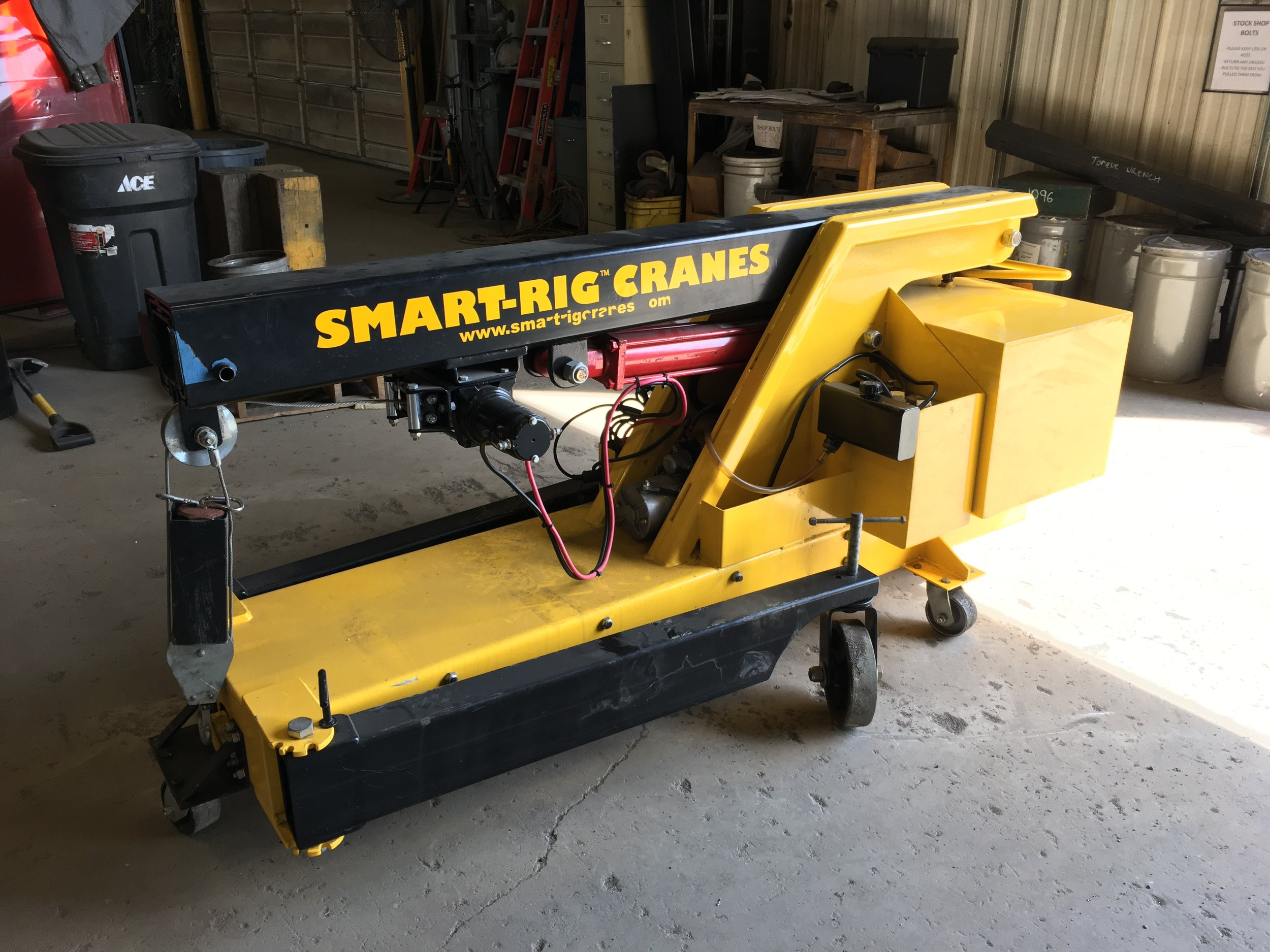 Smart Rig Crane - The Smart Rig Crane is a compact, portable mini-crane that has the ability to fit into tight spaces and can be transported by elevator, truck, or van.