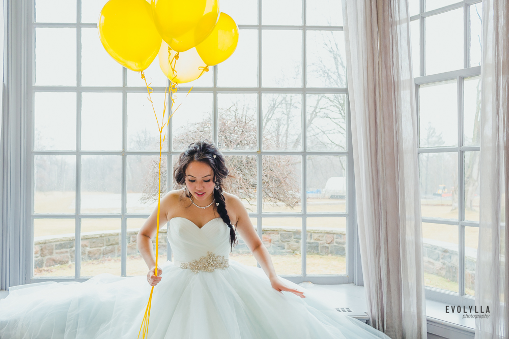 Bride with Yellow Balloons by the Window Photograph