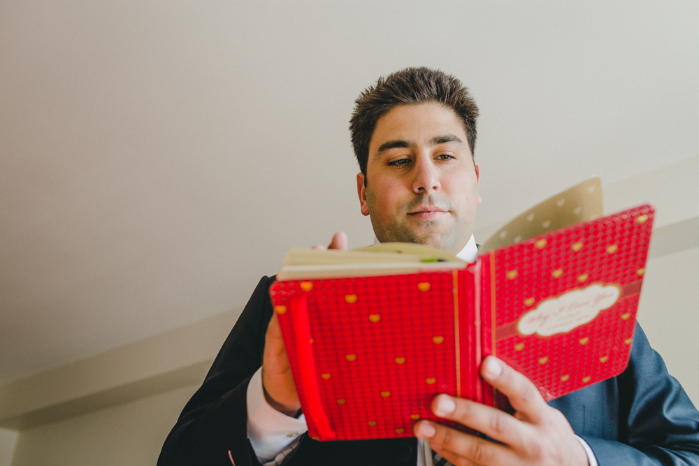 Groom reading Diary from Bride