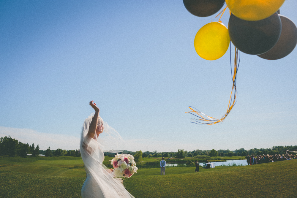 Bride Releasing Balloons Fun Wedding Photography