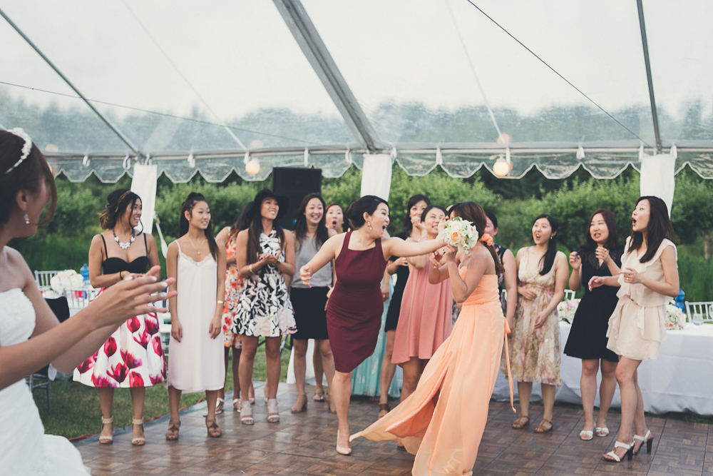Bouquet toss candid picture