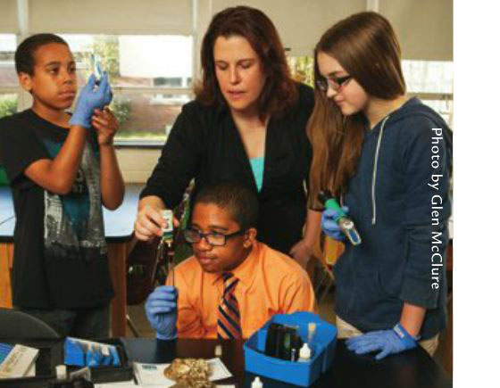Suffolk Middle School students test river water.