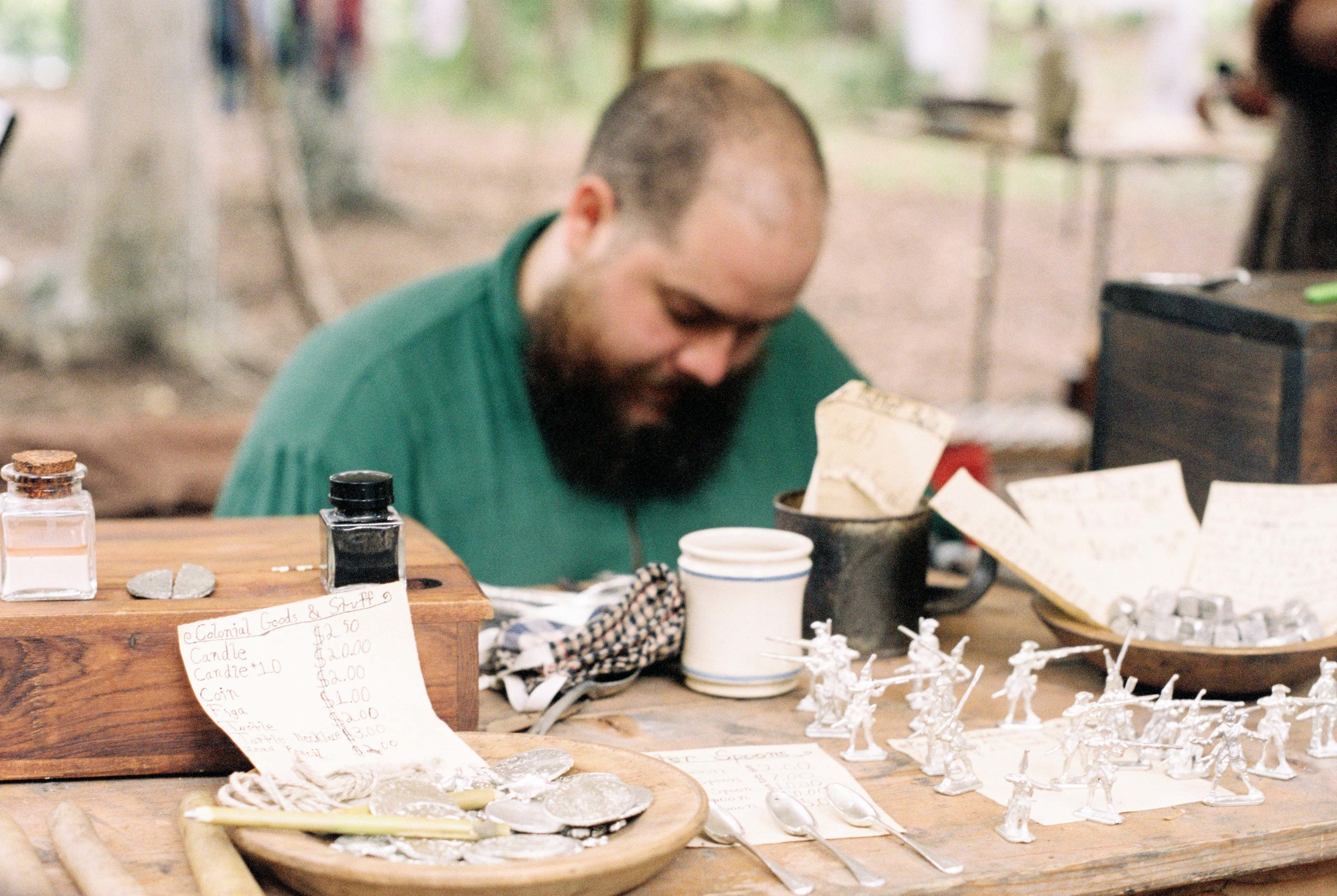 Authentic pewter toy soldiers, coins, and spoons being crafted on site by hand.
