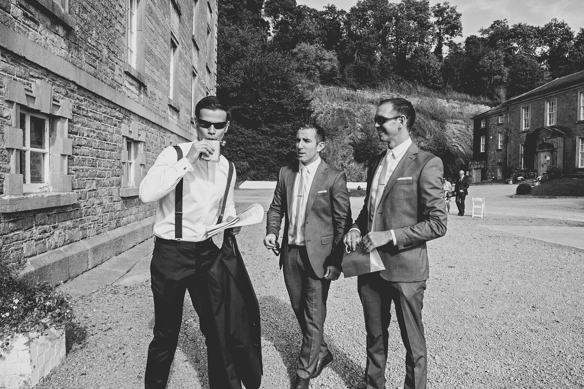 The Millhouse, Slane wedding 2014, Groom having a drink from hip flask