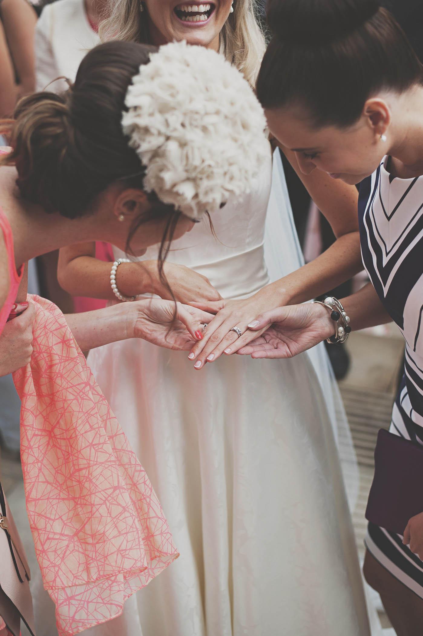 Lough Rynn Castle wedding, guests admire bride's wedding ring