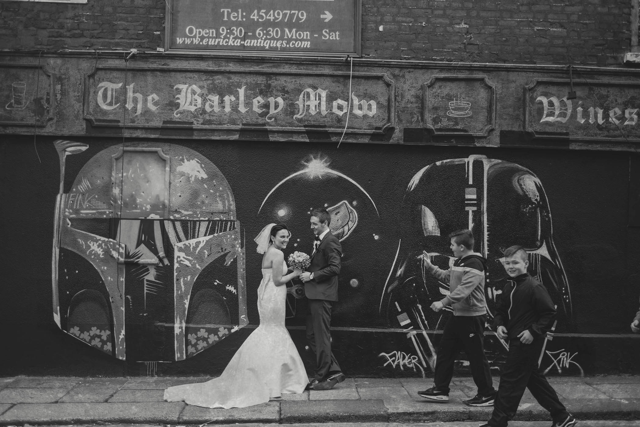 opportune photograph of people passing wedding couple