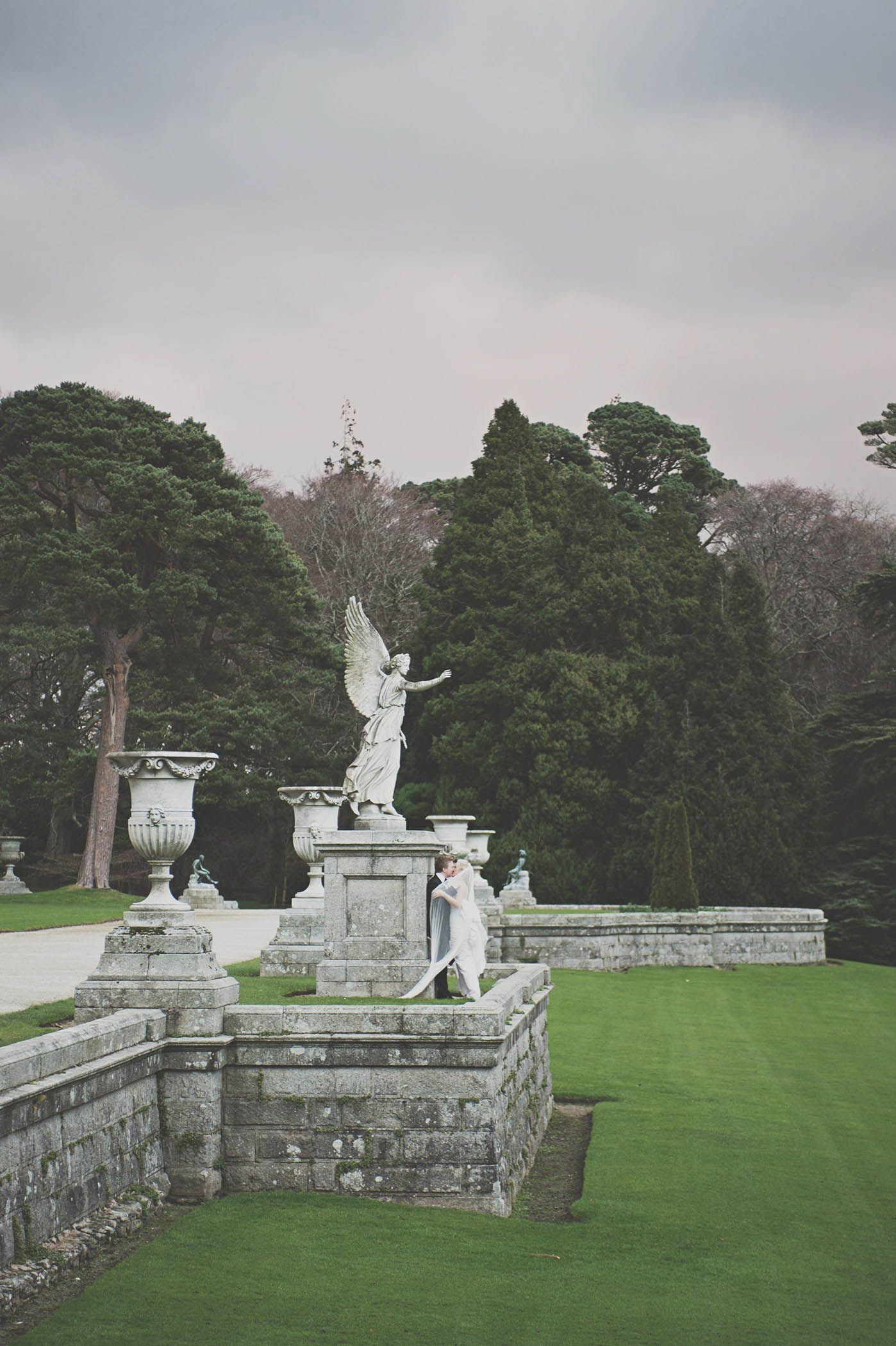 Wedding couple in formal gardens