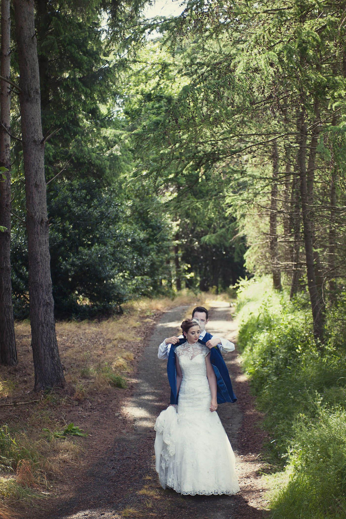 Druid's Glen wedding couple walk on grounds