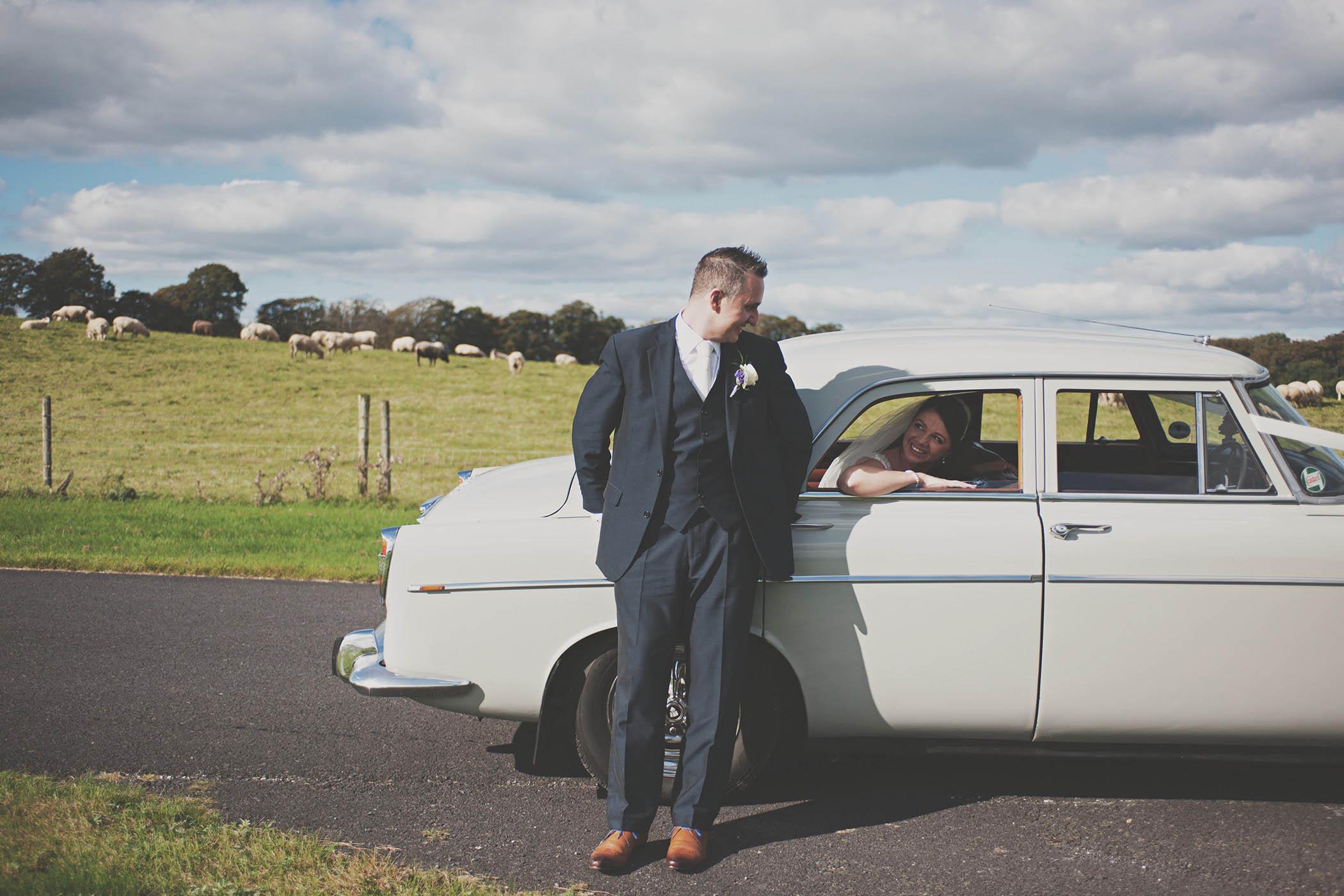 Wedding couple and white car