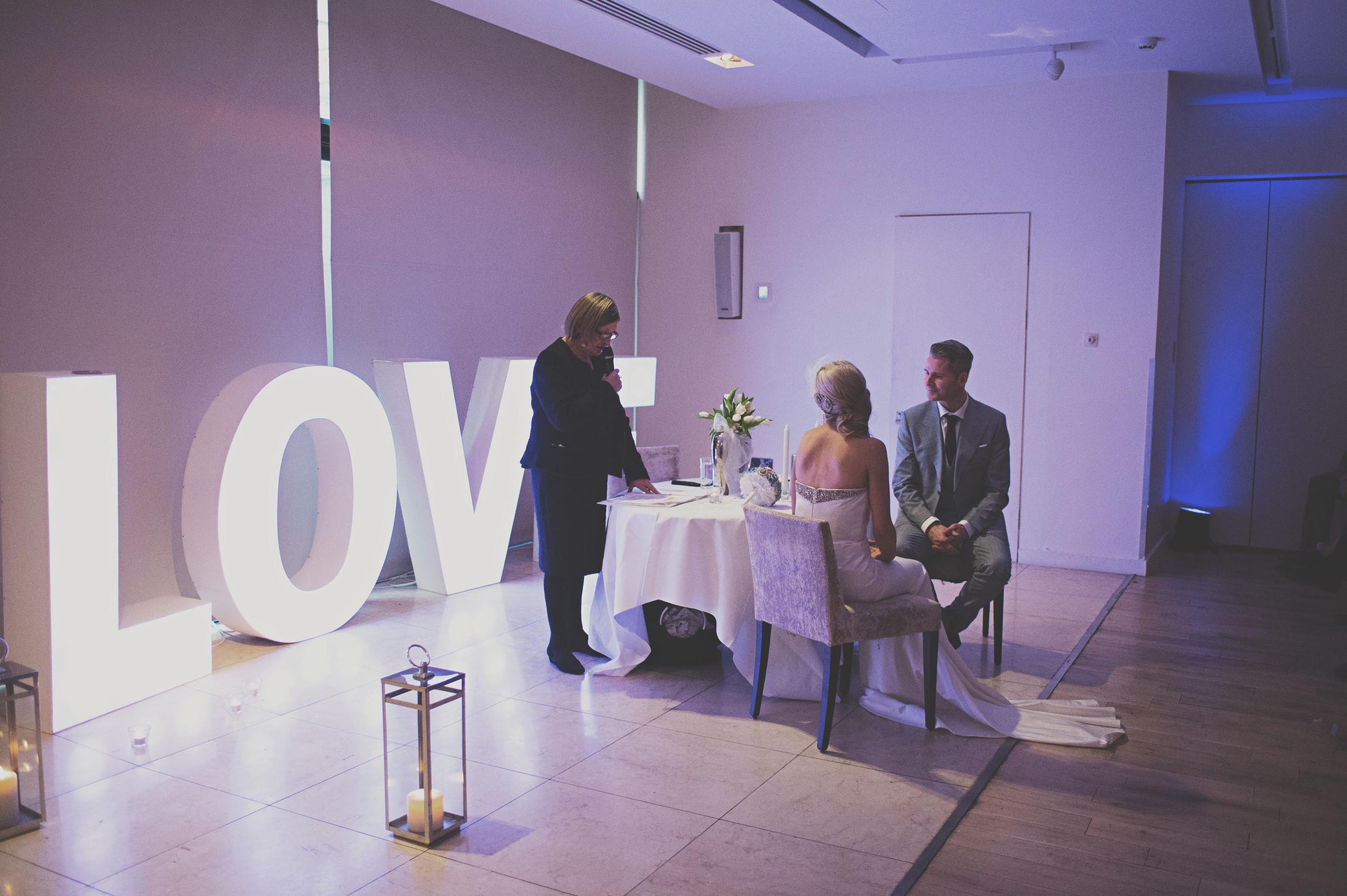 Celebrant talks to wedding couple