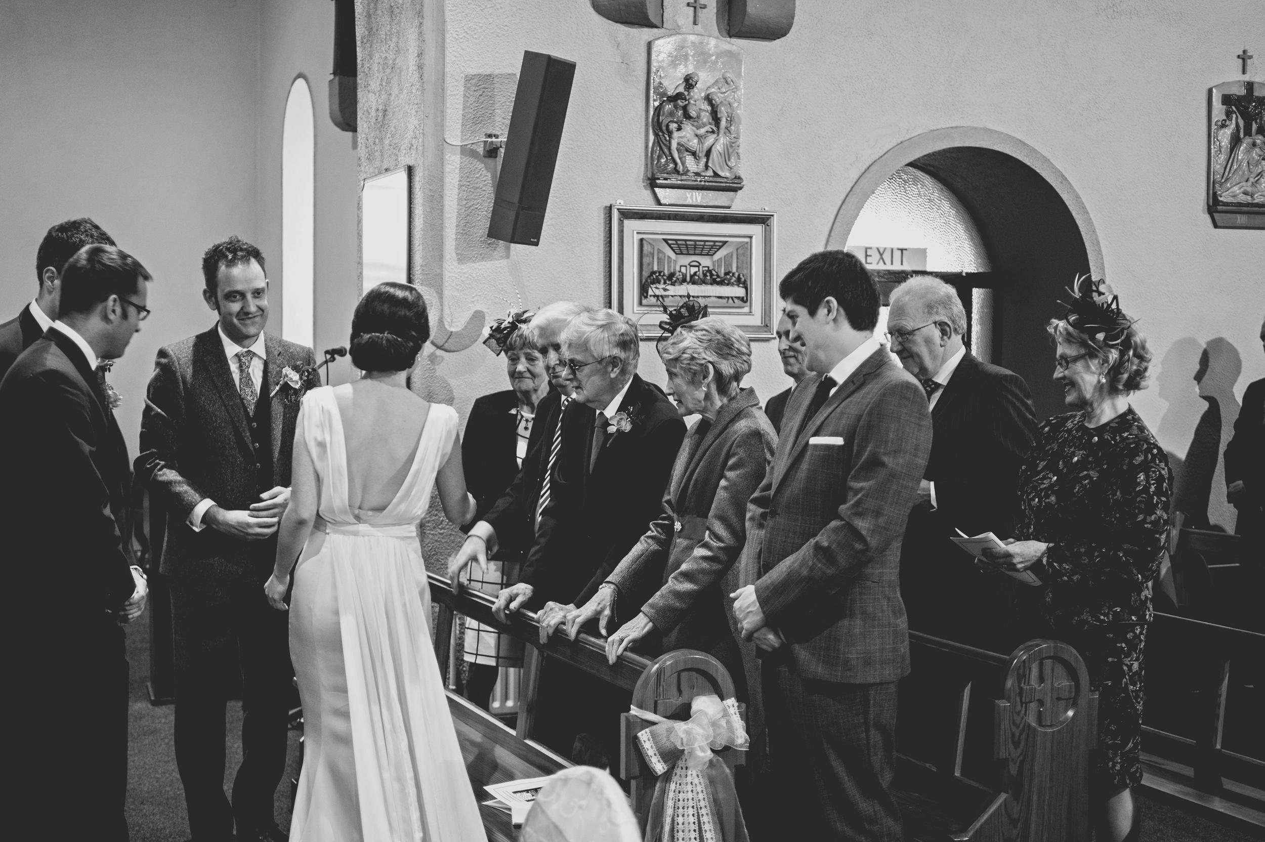 shaking hands at wedding service