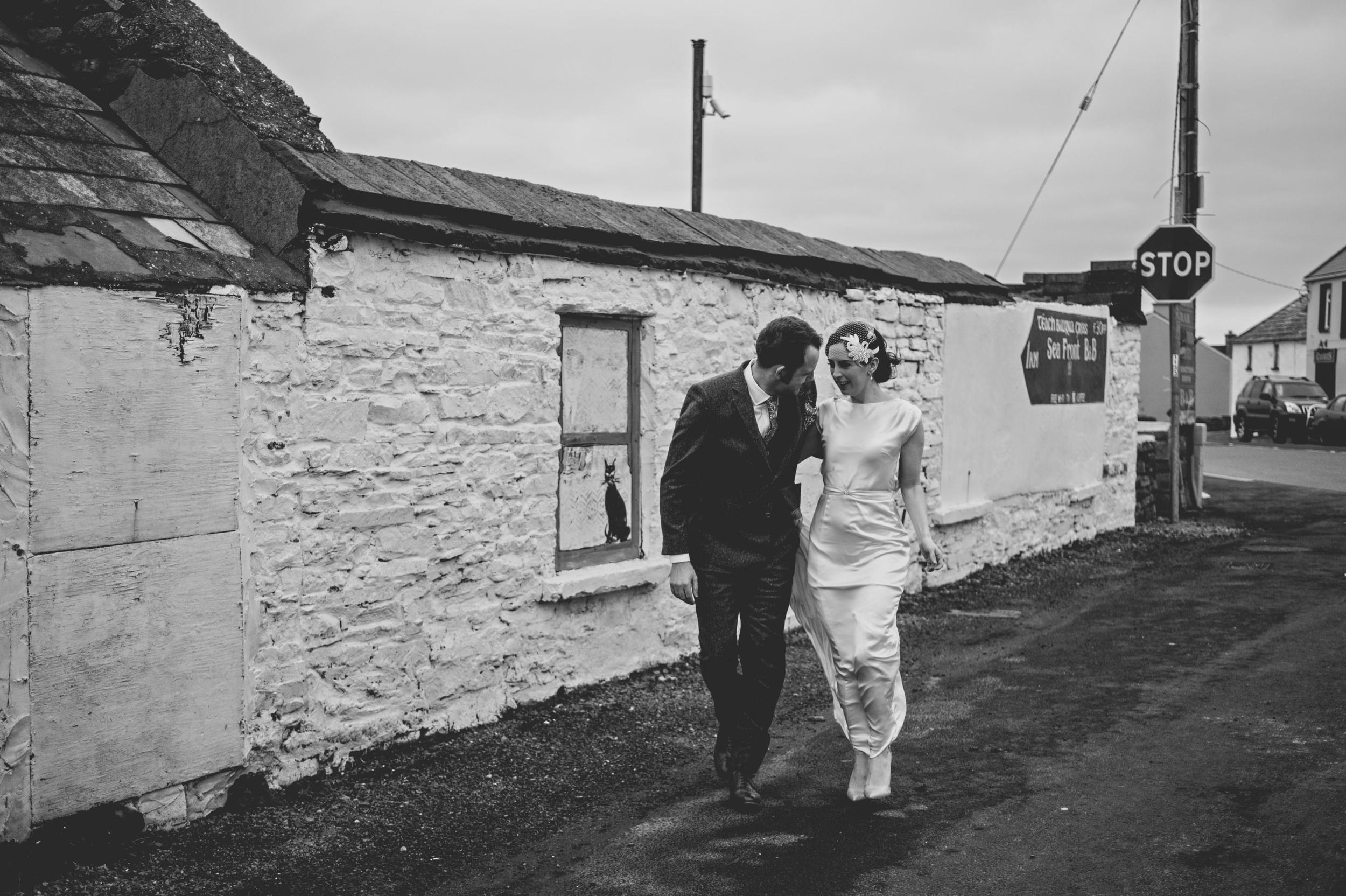 Wedding couple walking in Spanish Point
