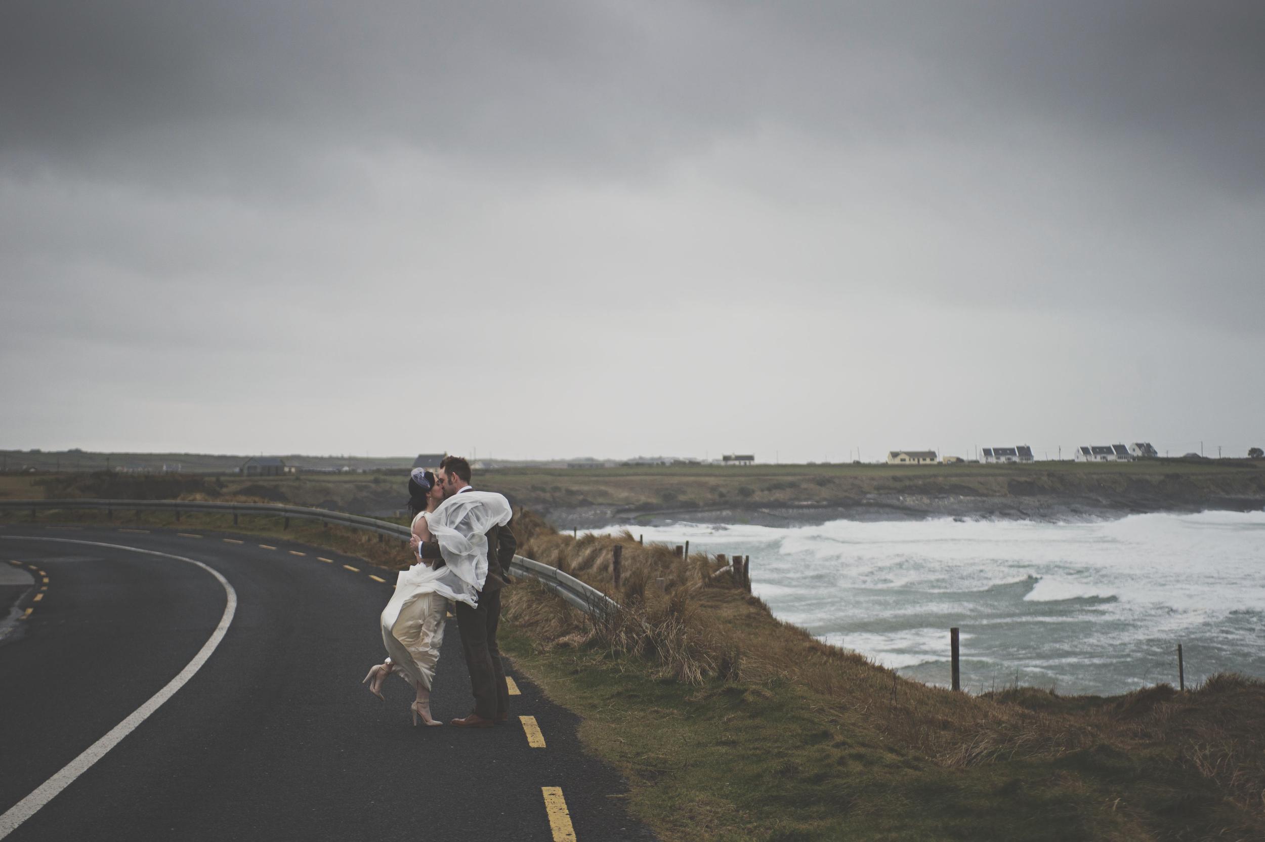 Wedding couple on coast road