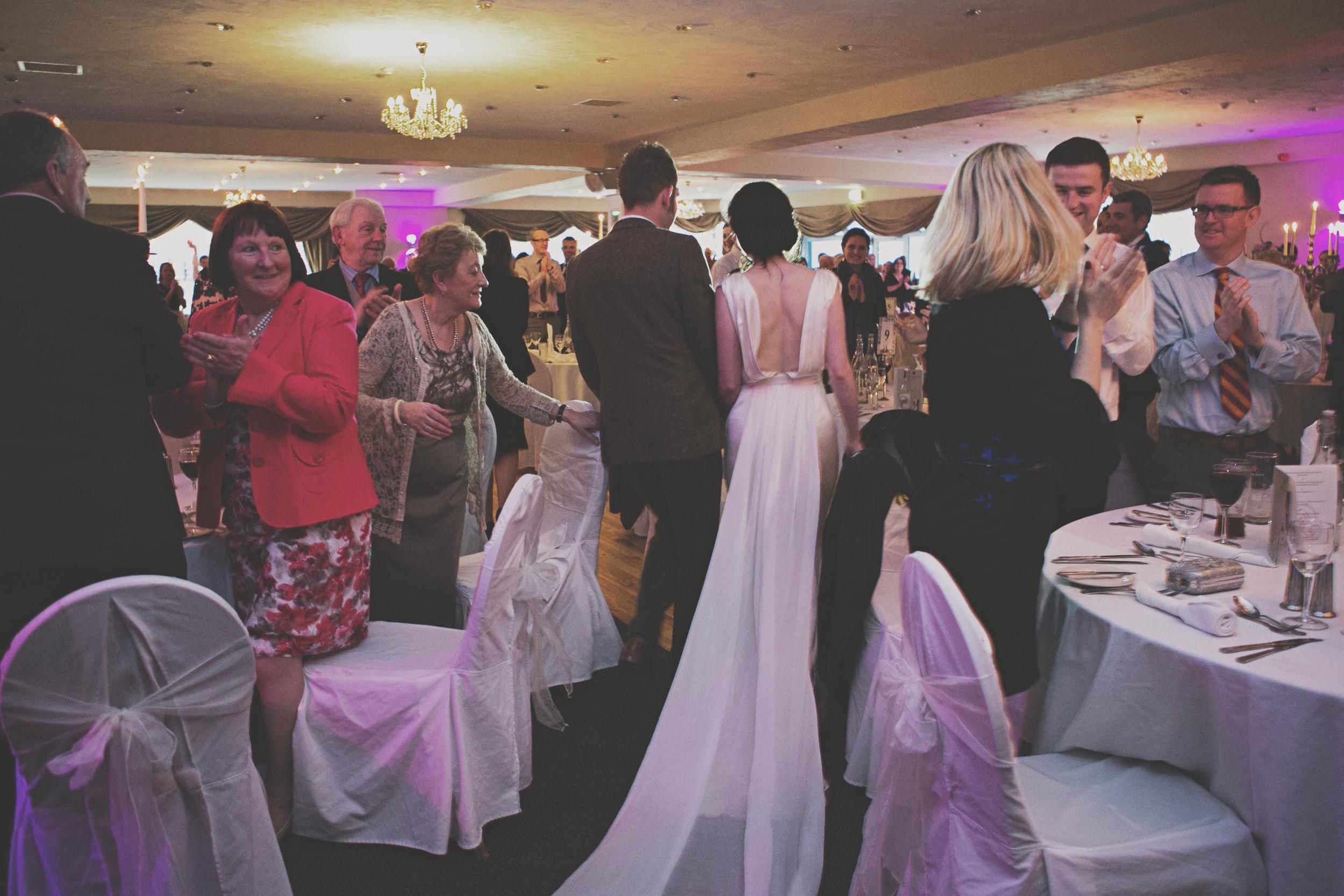 wedding couple enter their reception