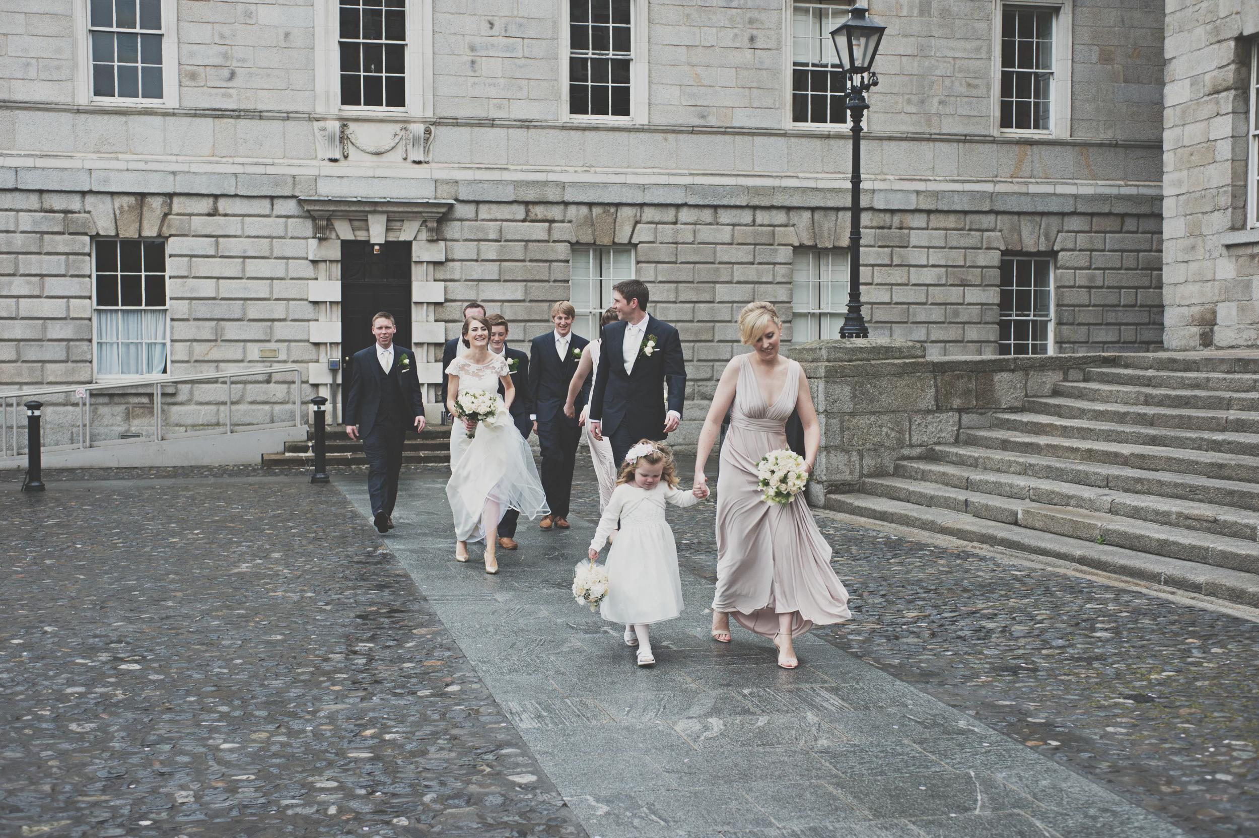 Wedding party walks through Trinity College Dublin