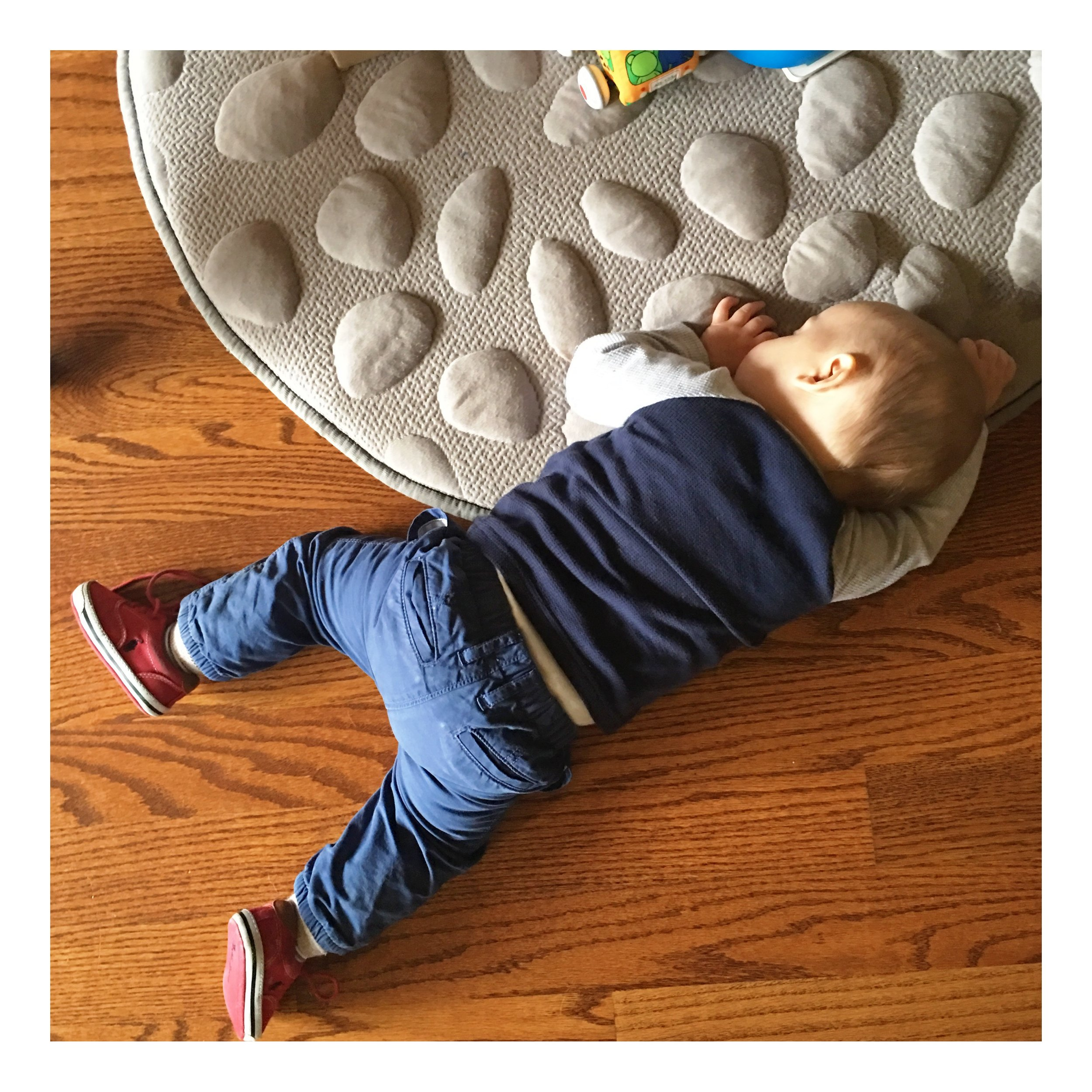 My son at eleven months calling it quits on the floor.