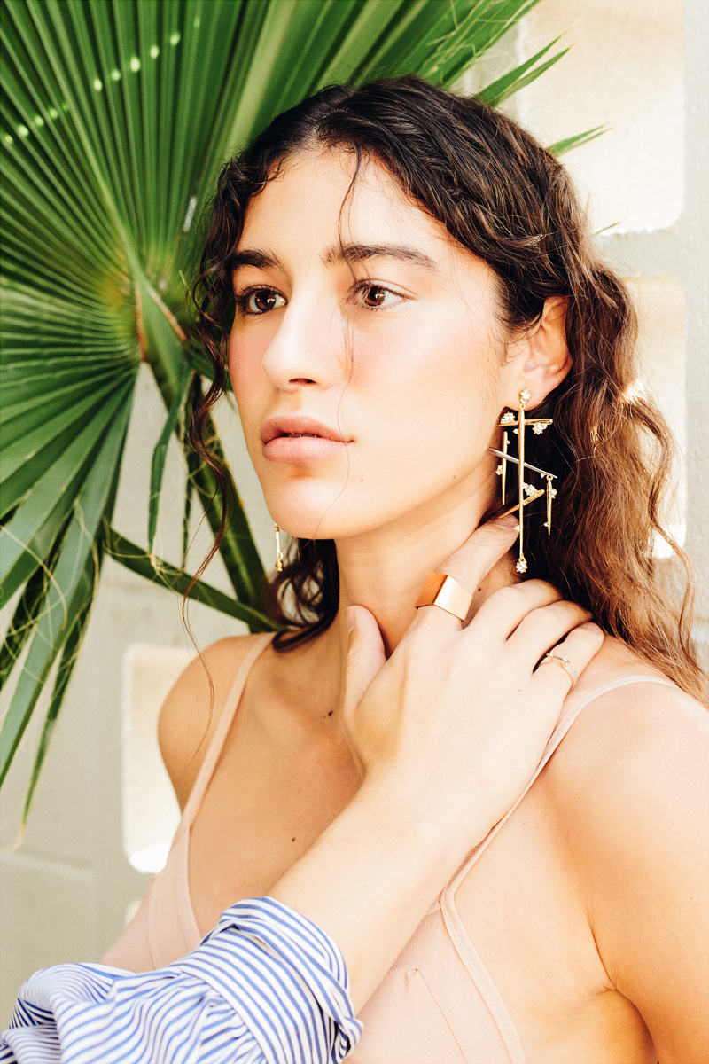 Him: rings- Limbo Jewelry.       Her: earring- Alexis Bittar.