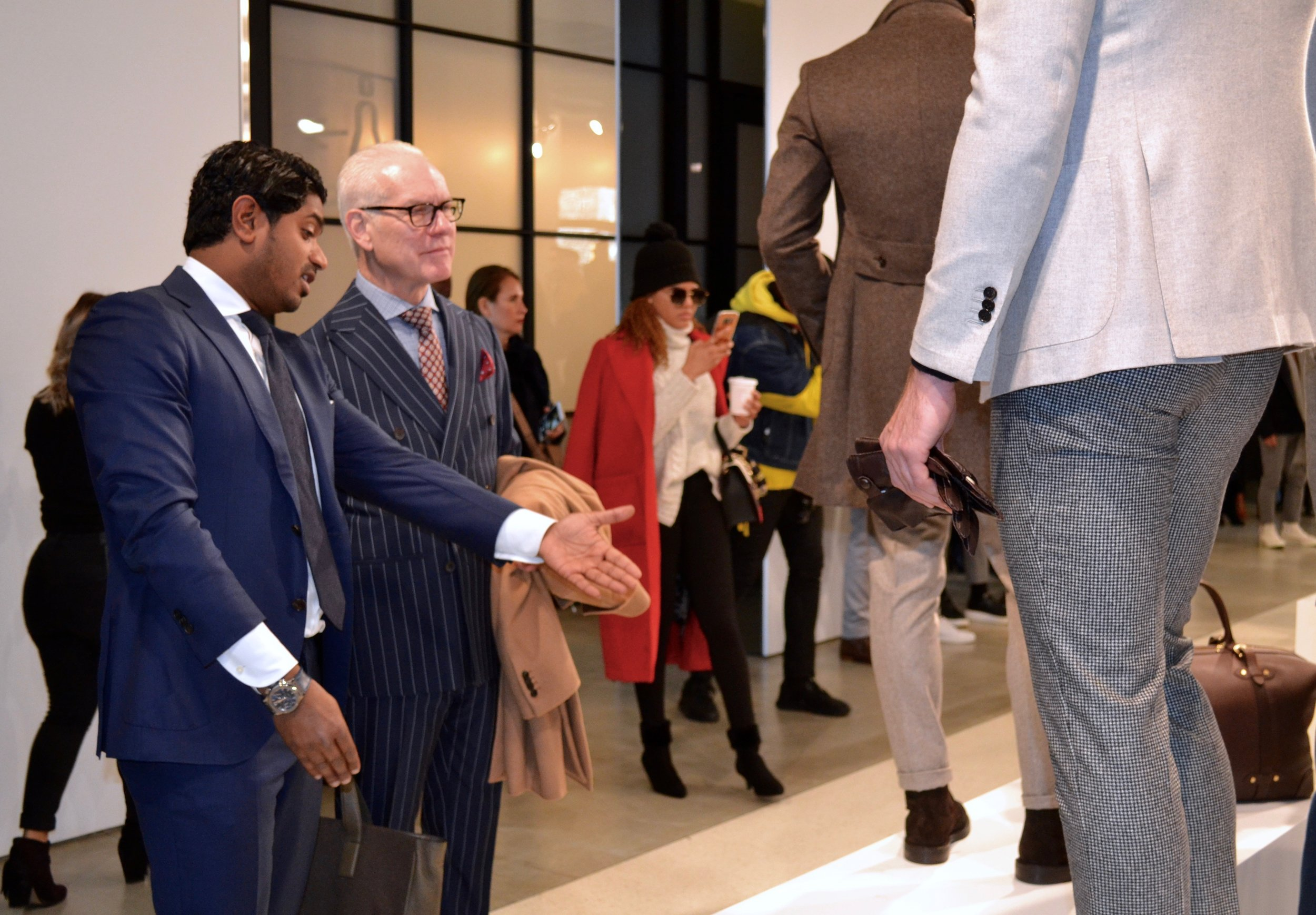 Tim Gunn viewing the Fall/Winter 2018 collection.