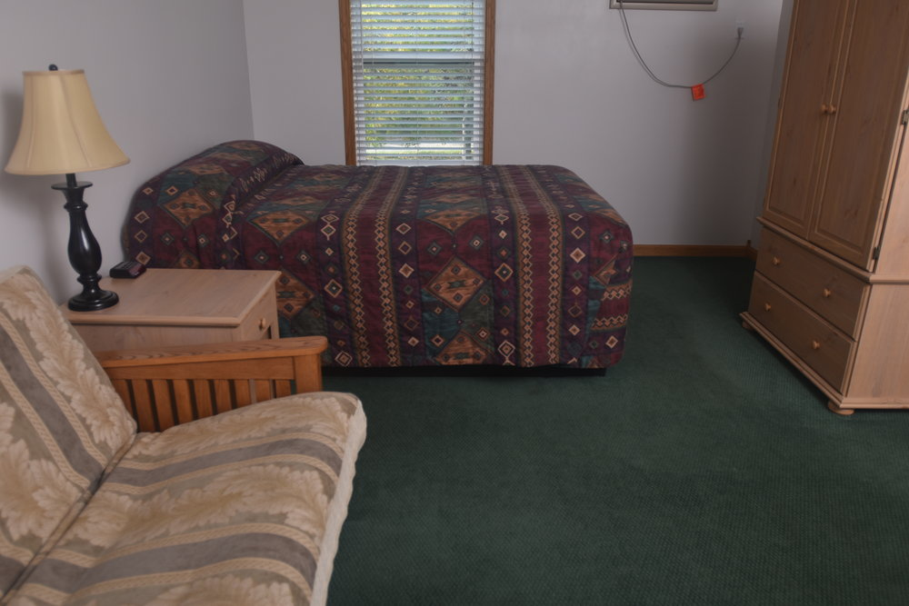 Blue Spruce Motel - Room Number 12 - Interior Bed and Entertainment Center.jpeg