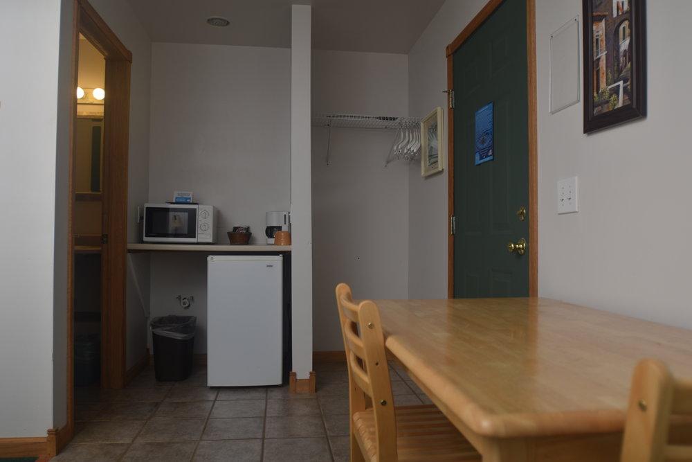 Blue Spruce Motel - Room Number 12 - Interior Entry and Fridge.jpeg