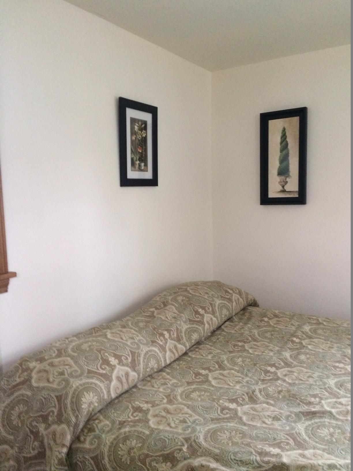 Blue Spruce Motel - Cabin Number 18 (1) - Interior Bed and Art.jpg