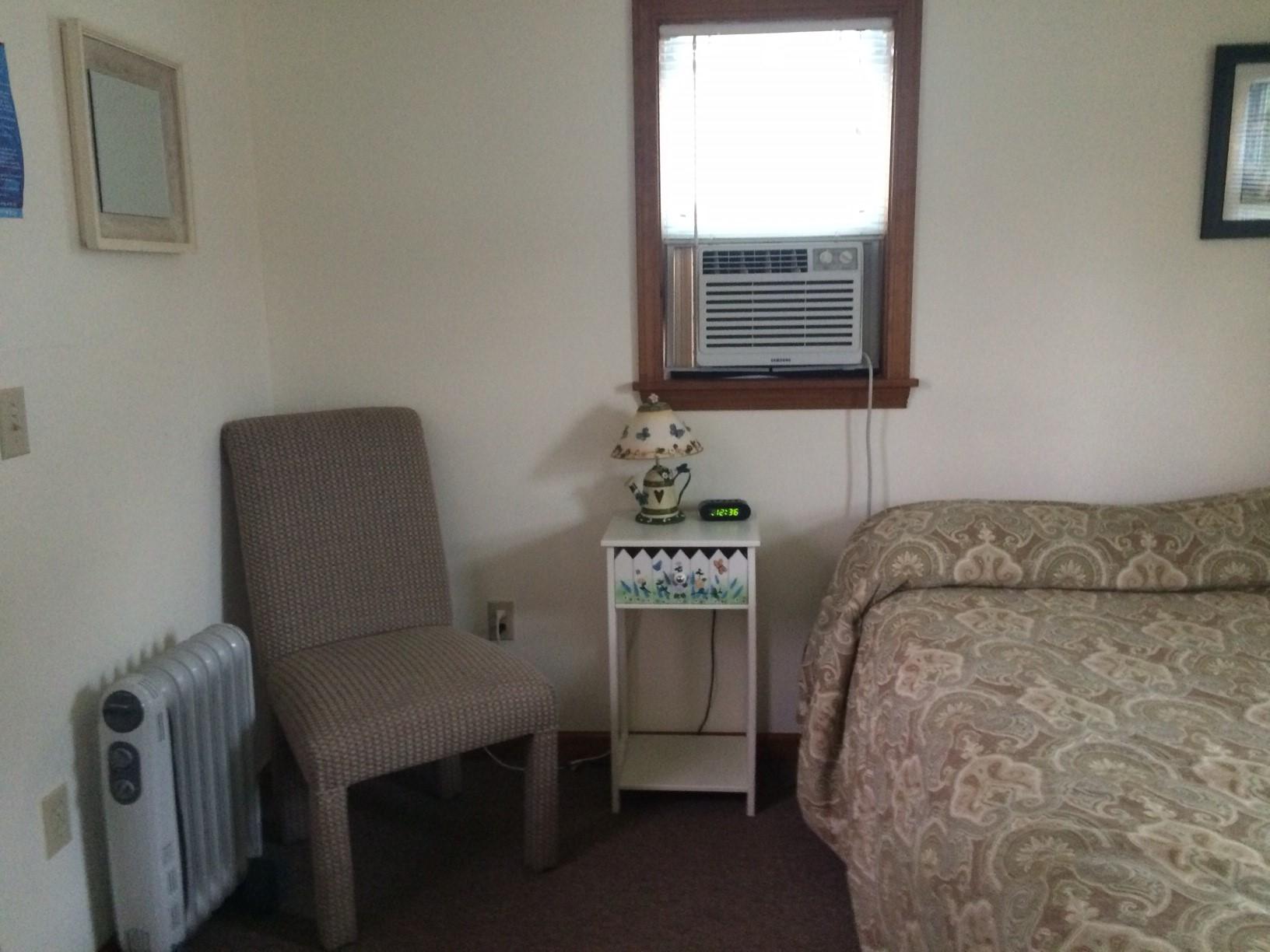 Blue Spruce Motel - Cabin Number 18 (1) - Interior Bed and Corner.jpg