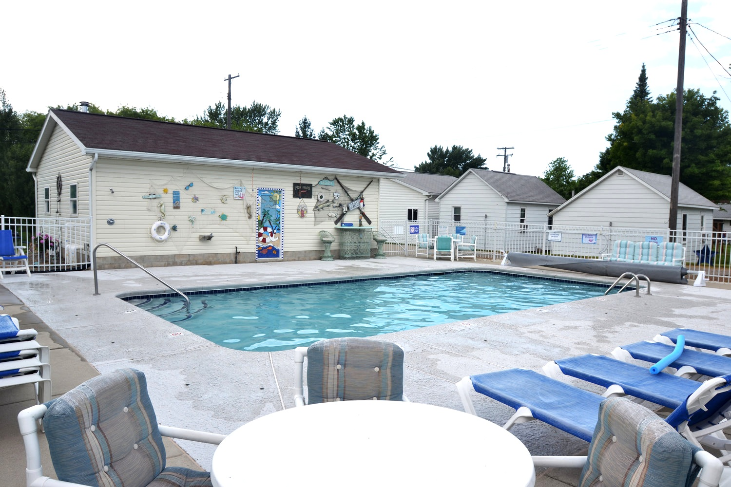 Blue Spruce Motel & Cabins - Close enough to the hustle and bustle of downtown Port Austin yet far enough away to relax and unwind.