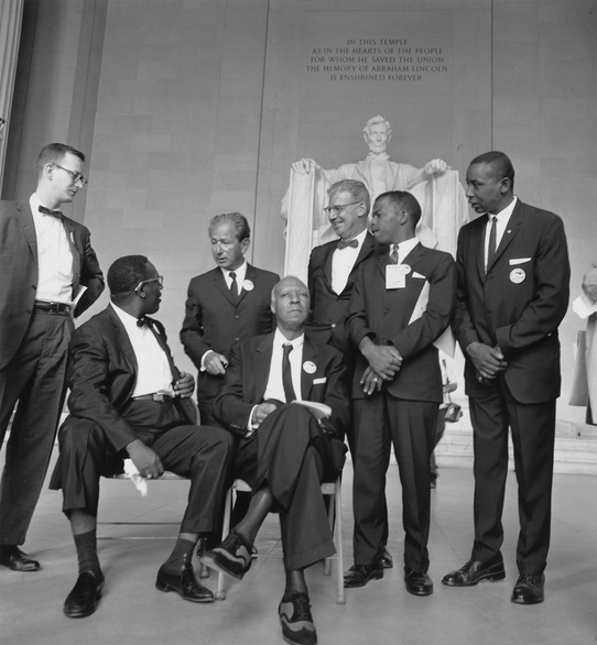 L to R- Mathew Ahmann, Cleveland Robinson, Rabbi Joachim Prinz, A. Philip Randolph, Joseph Rauh, Jr, John Lewis, Floyd McKissick, Photo Credit:   National Archives