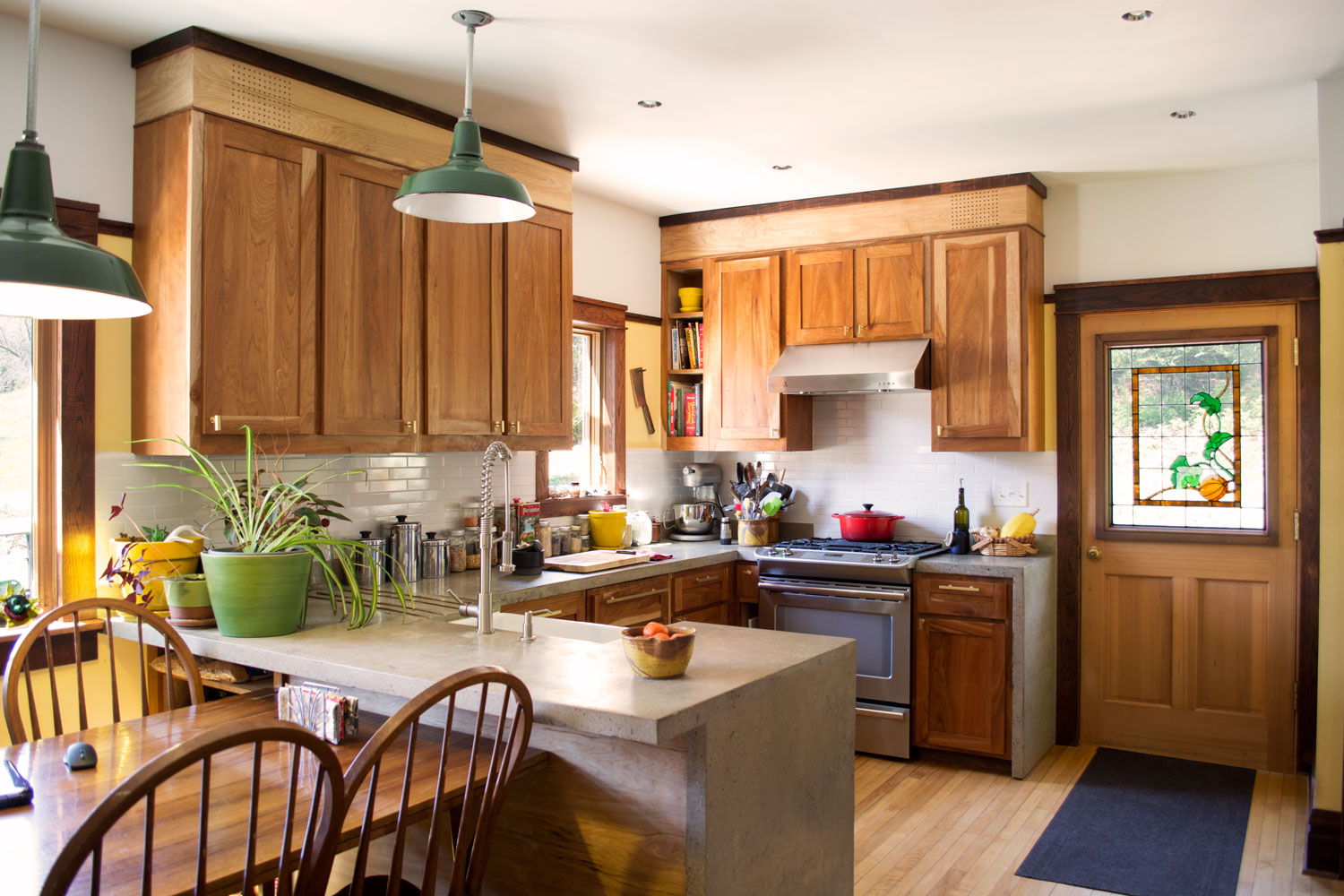 Cabinets fabricated from rustic cherry; counters poured-in-place concrete